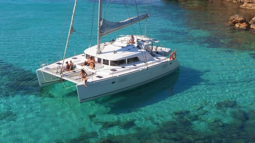 Catamaran anchored in a beautiful place of Ibiza